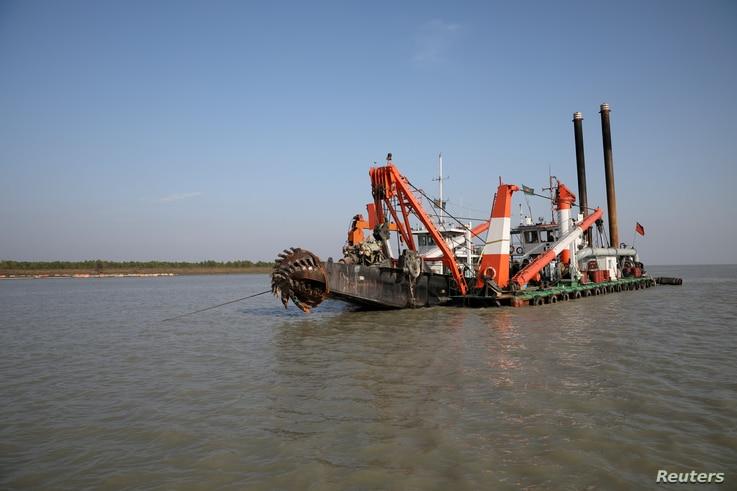 FILE - A dredging machine is seen near the island of Bhasan Char, in the Bay of Bengal, Bangladesh. Feb. 14, 2018.