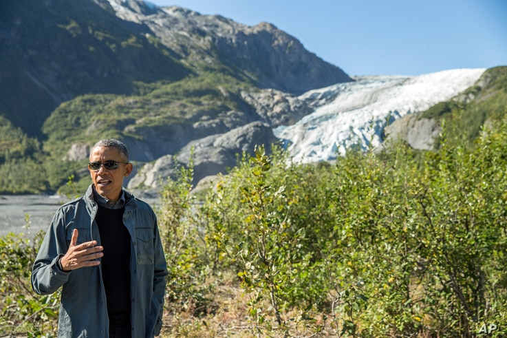 President Barack Obama speaks to members of the media while on a hike to the Exit Glacier in Seward, Alaska, Sept. 1, 2015.