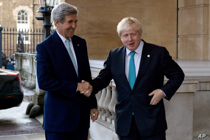 FILE - US Secretary of State John Kerry, left, is greeted by British Foreign Secretary Boris Johnson ahead of a meeting on the situation in Syria, at Lancaster House in London, Sunday Oct. 16, 2016.