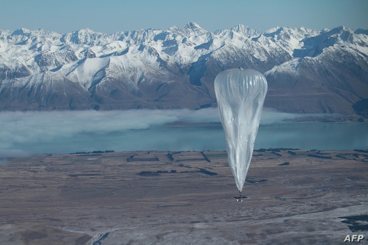 This handout photo taken on June 15, 2013 and received from Google on June 16 shows a Project Loon high altitude ballon sailing over Tekapo in Southern New Zealand after its launch. Google revealed top-secret plans on June 15 to send balloons to the ...