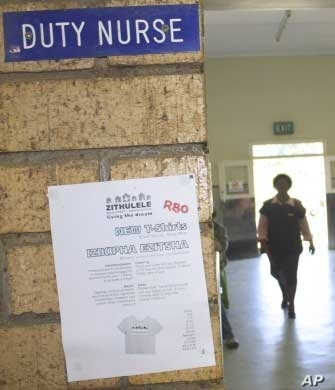 A nurse reports for duty at a South African hospital – but many are leaving the country's public health sector