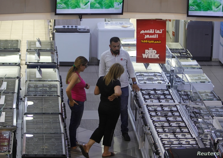 People shop inside Khoury, a home appliance store in Dora, east of Beirut, Lebanon, Aug. 6, 2018.