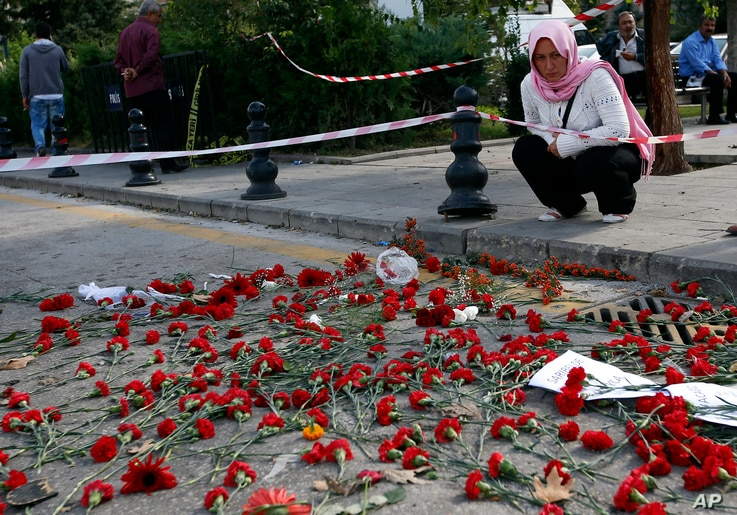 Flowers left behind by mourners are seen at the site of the Oct. 10 explosions in Ankara, Turkey, Oct. 13, 2015.