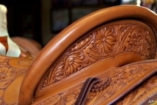 Many of Nancy Martiny's saddles are simple with the rough part of the leather exposed. Others, such as the one in this picture, sport ornate flower designs.