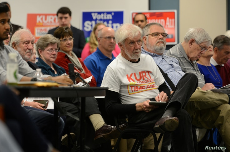 Voters listen to the candidates speak during a forum for Georgia's 6th Congressional District special election in Marietta, Georgia, April 3, 2017.
