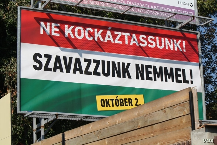 """Two days before Hungary votes on whether it will reject European Union mandated refugee minimums, this poster urges people to vote """"no,"""" Sept. 30, 2016. (VOA/H. Murdock)"""