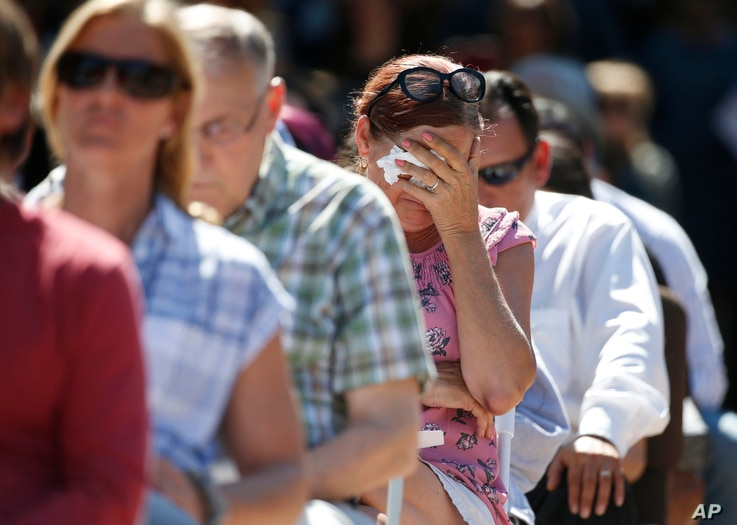 Attendees react at a prayer vigil for the victims of the shooting at Marjory Stoneman Douglas High School at the Parkland Baptist Church in Parkland, Fla., Feb. 15, 2018.