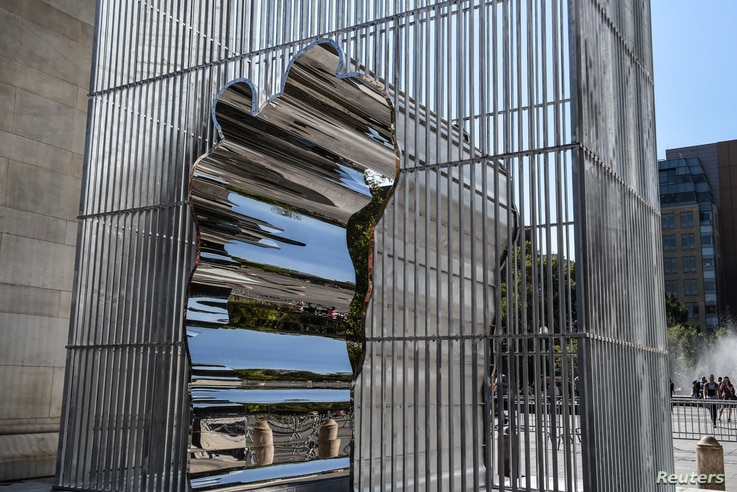 """One of Ai Weiwei's sculptures for his project """"Good Fences Make Good Neighbors"""" is seen in Washington Square Park in New York City, Oct. 6, 2017."""