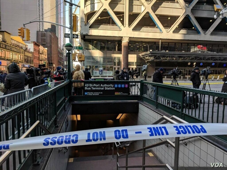 Police at the scene of explosion near Port Authority Bus Terminal in New York City, Dec. 11, 2017.