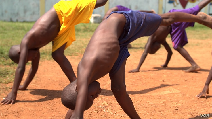 "Several young orphans practice the capoeira moves needed to participate in a ""roda"" — a ""round"" where the participants dance and perform martial arts moves to music, April 20, 2017. (Photo: Z. Baddorf/VOA)"