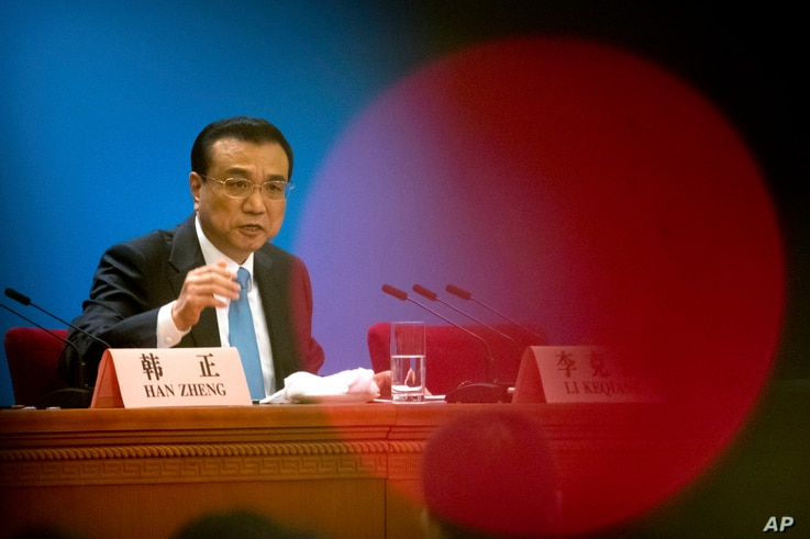 Chinese Premier Li Keqiang speaks during a press conference after the closing session of China's National People's Congress (NPC) at the Great Hall of the People in Beijing, March 20, 2018.