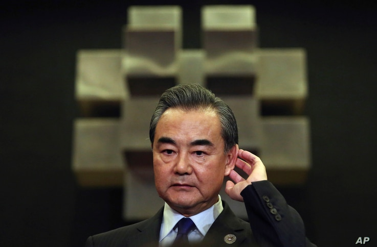 Chinese Foreign Minister Wang Yi gestures as he answers questions from reporters as he attends the 50th ASEAN Foreign Ministers' Meeting and its dialogue partners in Manila, Philippines,  Aug. 6, 2017.