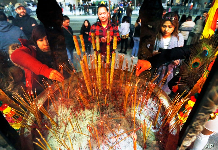 Celebrants light incense at the Thien Hau temple in Los Angeles, Jan. 28, 2017, the first day of the Lunar New Year - the Year of the Rooster.