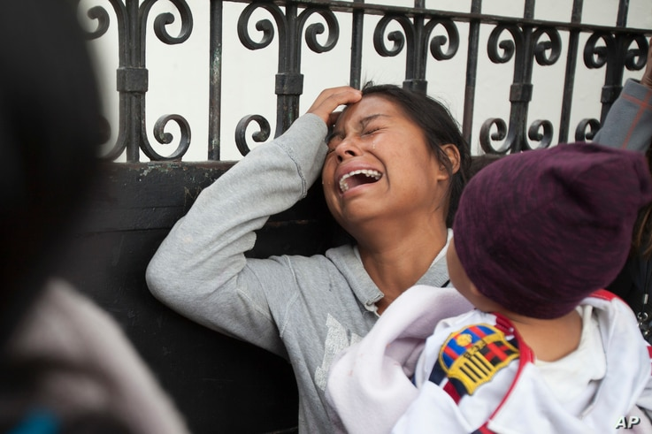 A relative of a youth who resided at the Virgin of the Assumption Safe Home wails as she waits for the release of the names of those who died in a fire at the shelter, outside the morgue where the bodies are being identified in Guatemala City, March ...