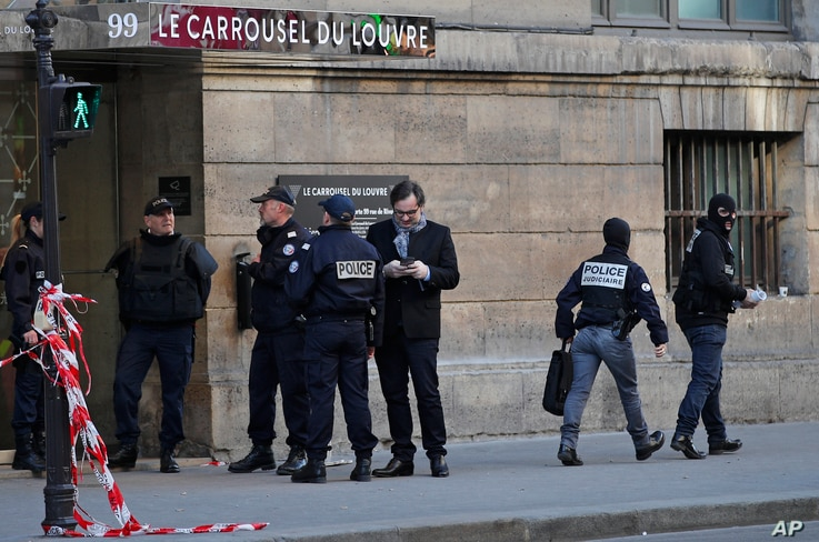 Police officers cordon off the area outside the Louvre museum near where a soldier opened fire after he was attacked in Paris, Feb. 3, 2017.