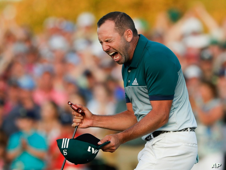 Sergio Garcia reacts after making his birdie putt on the 18th green to win the Masters, April 9, 2017.