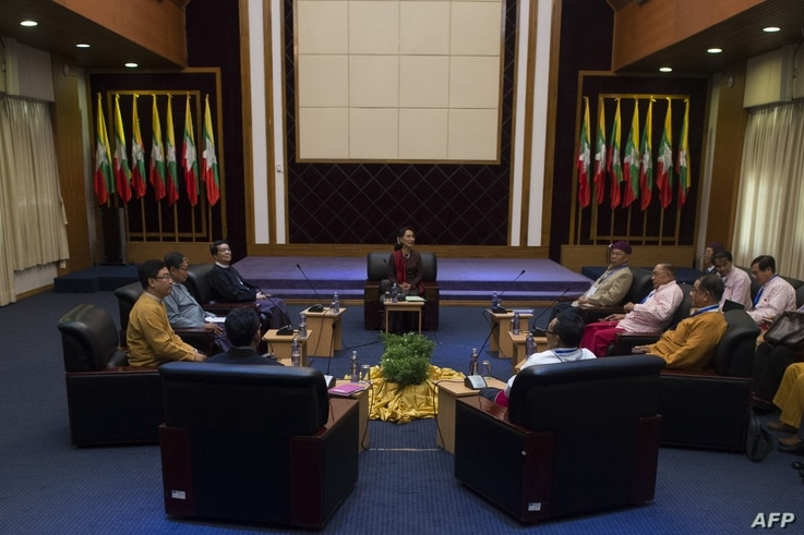 Myanmar's State Counsellor Aung San Suu Kyi (C) holds talks with leaders from the United Nationalities Federal Council (UNFC) at the National Reconciliation and Peace Centre (NRPC) in Yangon on July 17, 2016.