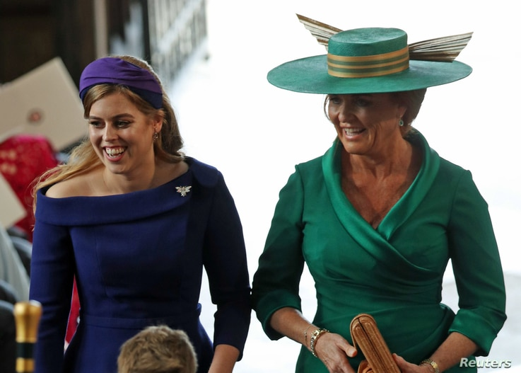 Princess Beatrice of York and Sarah, Duchess of York arrive at the wedding of Princess Eugenie to Jack Brooksbank at St George's Chapel in Windsor Castle, Britain, Oct.12, 2018.