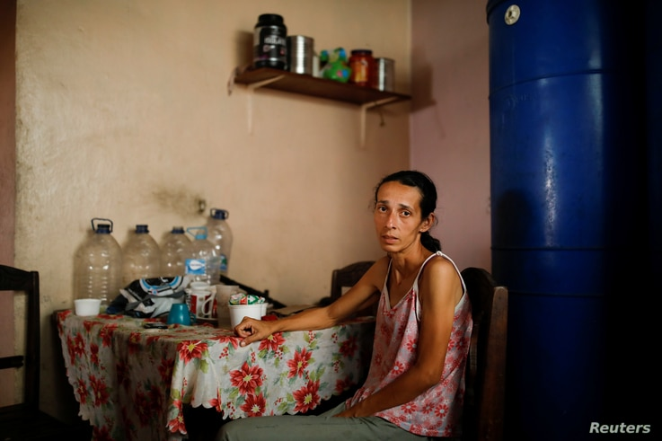 Yaneidi Guzman, 38, poses for a picture at her home in Caracas, Venezuela, Feb. 17, 2019. Guzman has lost a third of her weight over the past three years as Venezuela's economic collapse made food unaffordable.