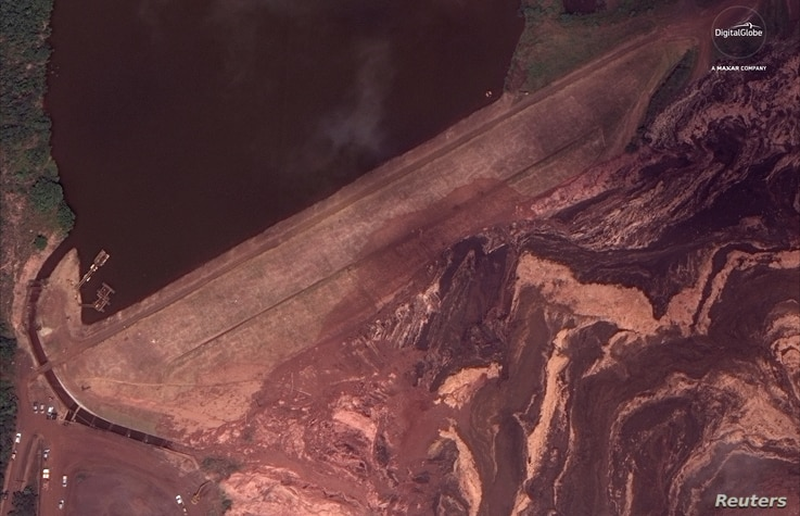 The dam at Vale's Corrego do Feijao mine near Brumadinho, Brazil, is pictured after it's Jan. 25, 2019 collapse in this Jan. 26, 2019 handout satellite photo.