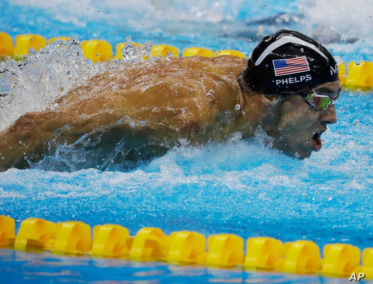 United States' Michael Phelps competes in the men's 4 x 100-meter medley relay final during the swimming competitions at the 2016 Summer Olympics, Aug. 13, 2016, in Rio de Janeiro, Brazil.
