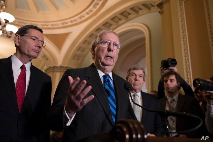 Senate Majority Leader Mitch McConnell, R-Ky., flanked by Sen. John Barrasso, R-Wyo., left, and Sen. Roy Blunt, R-Mo., meets with reporters as work continues on a plan to keep the government open as a funding deadline approaches, at the Capitol in Wa...