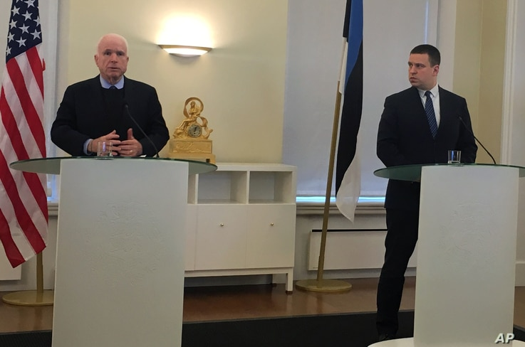 U.S. Senator John McCain, left, speaks during a joint news conference with the Estonian Prime Minister Juri Ratas in Tallinn, Tuesday, Dec. 27, 2016.