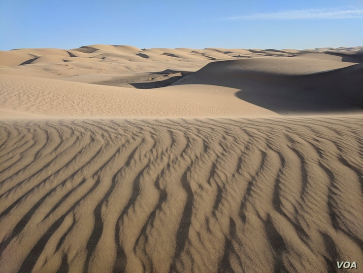 The Imperial Sand Dunes grace a stretch of the 127 kilometers that separate San Luis, Ariz., and Calexico, Calif.