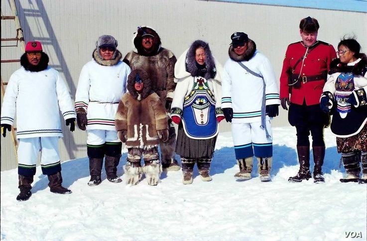 A group of Inuit in traditional dress pose during a ceremony on the occasion of the foundation of Nunavut, the homeland of the Inuit people of northern Canada, April 1, 1999.