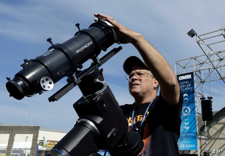 Ray Cooper, volunteer for the Oregon Museum of Science and Industry, preps his equipment to provide live video of the Aug. 21, 2017, solar eclipse at the state fairgrounds in Salem, Ore., Sunday, Aug. 20, 2017.