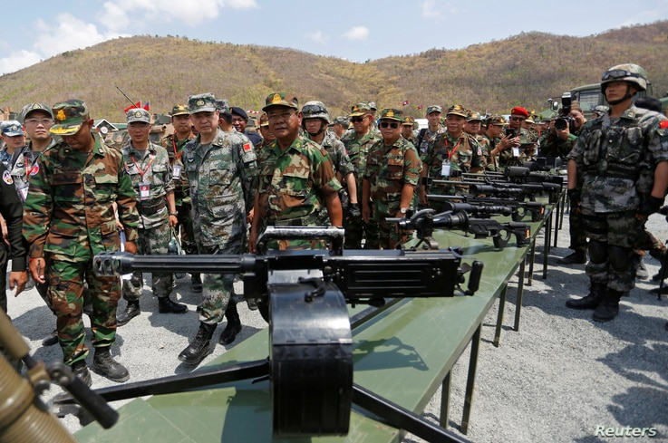 Major General Zhang Jian, commander of the Chinese People's Liberation Army Southern Theatre Command, and Pol Saroeun, commander-in-chief of the Cambodian military, attend the opening of military exercise in Kampong Speu province, Cambodia, March 17,