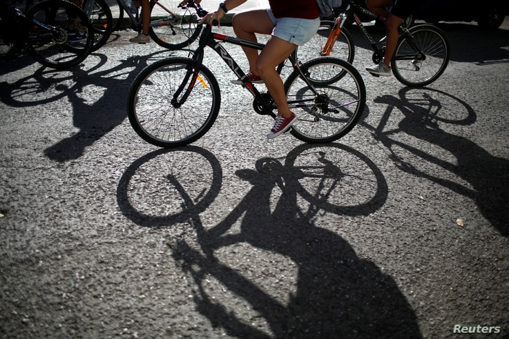 Bicyclists take part in a ride organized by BLH Masa Critica Habana to promote cycling as a clean and sustainable mode of transport, in Havana, Cuba, Aug. 5, 2018.