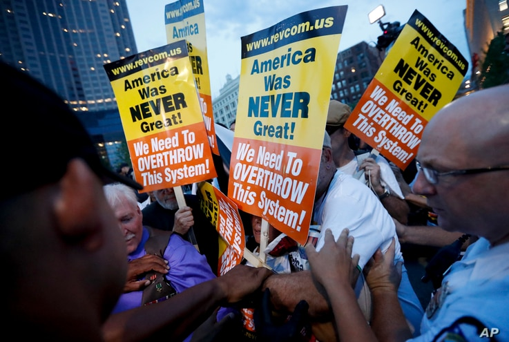 Protesters clash in Public Square on July 21, 2016, in Cleveland, during the final day of the Republican convention.