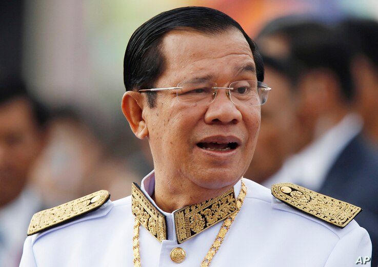FILE - Cambodia's Prime Minister Hun Sen waits to attend Independence Day celebrations in Phnom Penh, Cambodia, Nov. 9, 2017.