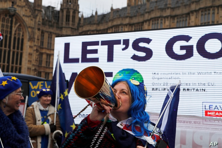 A pro-European demonstrator protests in front of a Leaver campaign board opposite the Houses of Parliament in London, Jan. 15, 2019, ahead of lawmakers' vote on whether to accept British Prime Minister Theresa May's Brexit deal. Later, the plan was s...