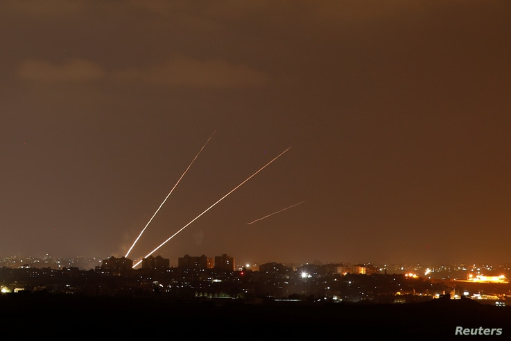 Streaks of light are pictured as rockets are launched from the northern Gaza Strip towards Israel, as seen from Sderot, Israel, Aug. 8, 2018.