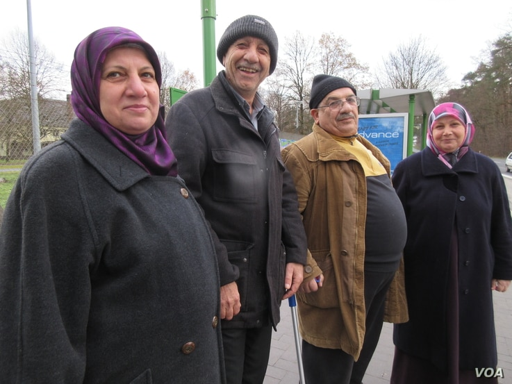 Abdul Hameed Omar, with cane, at a bus stop in Giessen, Germany, with his friends.