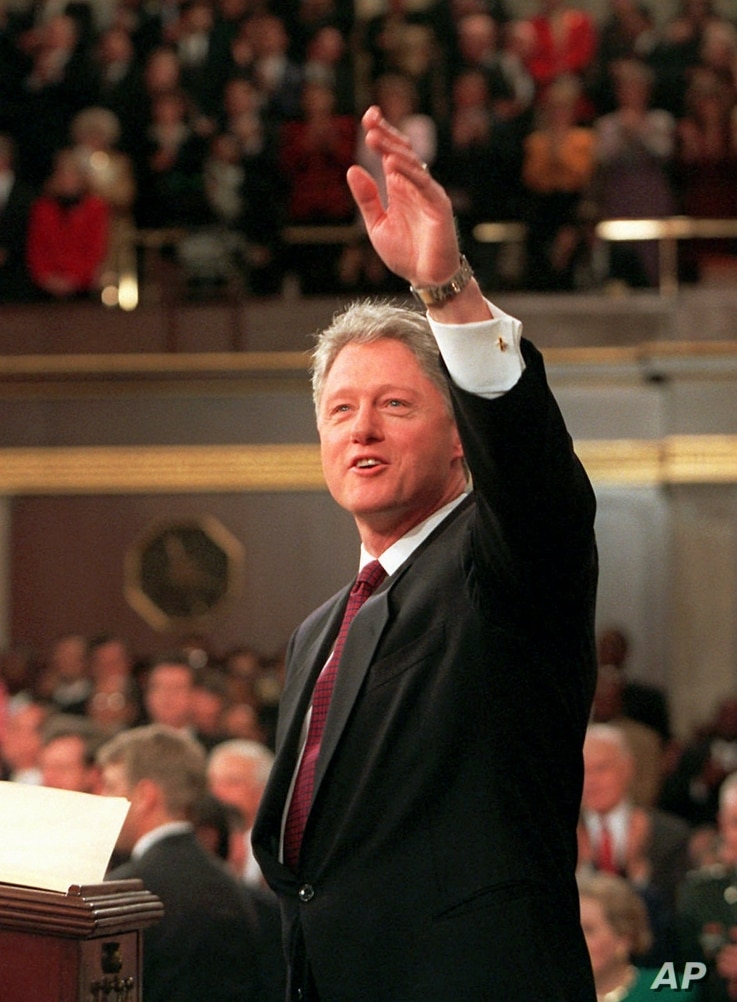FILE - President Bill Clinton waves prior to giving his State of the Union address, Jan. 23, 1996 on Capitol Hill.