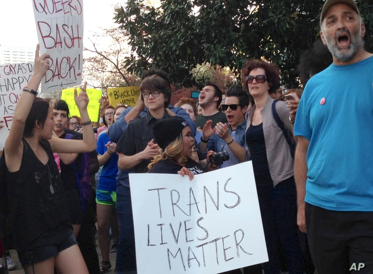 FILE - People protest outside the North Carolina Executive Mansion in Raleigh, N.C. A South Carolina proposal to forbid transgender people from using restrooms that correspond to their gender identity is part of a backlash by lawmakers across the his...