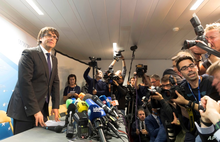 Deposed Catalan president Carles Puigdemont is seen after wrapping up a press conference in Brussels, Belgium, Oct. 31, 2017.