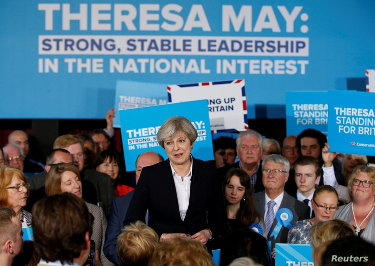 Britain's Prime Minister Theresa May delivers a speech to Conservative Party members in Mawdesley village hall, Ormskirk, Britain May 1, 2017.