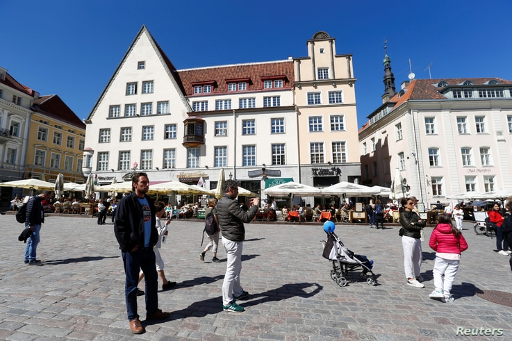 FILE - People gather in the Town Square in Tallinn, Estonia, May 31, 2018.