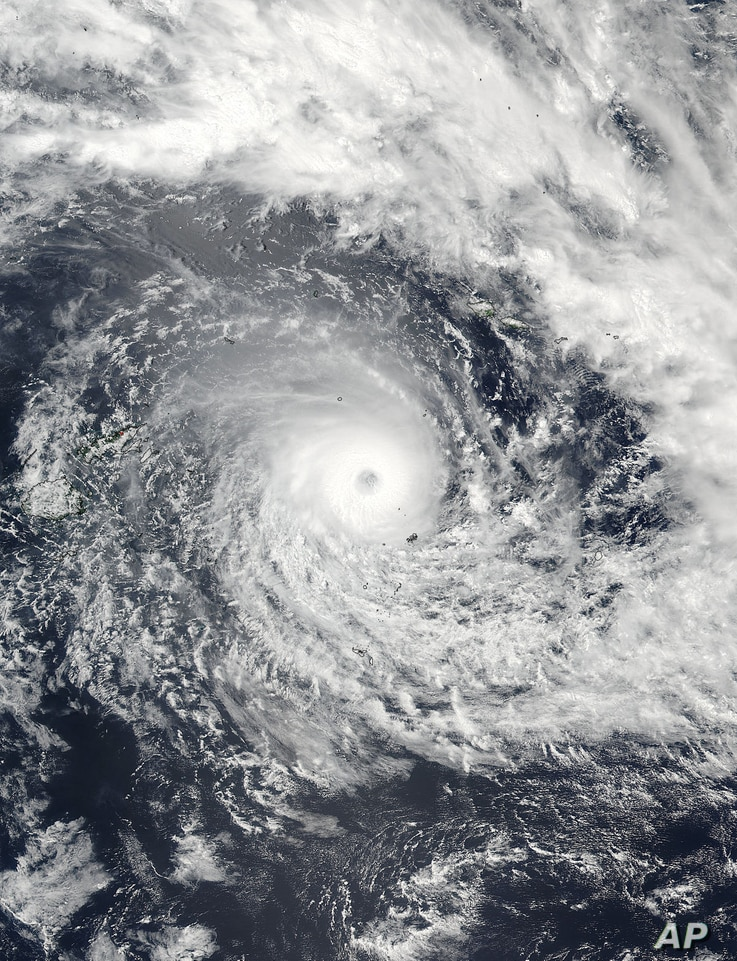 A satellite image released by NASA Goddard Rapid Response shows Cyclone Winston in the South Pacific Ocean, Feb. 19, 2016. The Pacific island nation of Fiji readied as a formidable cyclone with winds of 300 kph(186 miles) bore down.