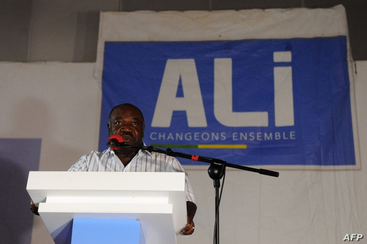 Gabon's incumbent president Ali Bongo Ondimba speaks to members of his campaign at election offices in Libreville, Aug. 28, 2016.