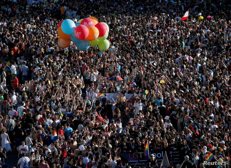 Hundreds of thousands of people attend the World Pride parade in Madrid, Spain, July 1, 2017. The 10-day festival highlighting gay rights ends Sunday.