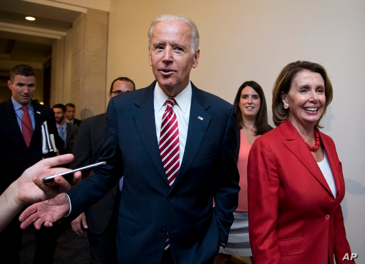 Vice President Joe Biden and House Minority Leader Nancy Pelosi of Calif., leave a meeting with the House Democratic Caucus about the Iran nuclear deal, July 15, 2015, on Capitol Hill in Washington.