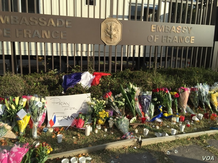 A memorial to victims of the coordinated terrorist attacks in Paris Friday grows outside the French Embassy in Washington, D.C., Nov. 14, 2015.