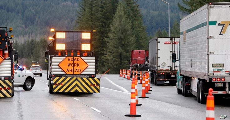 Traffic is diverted off eastbound Interstate 90 before Snoqualmie Pass in North Bend, Wash., Jan. 18, 2017. An ice storm shut down parts of major highways and interstates in Oregon and Washington state and paralyzed some towns along the Columbia Rive...