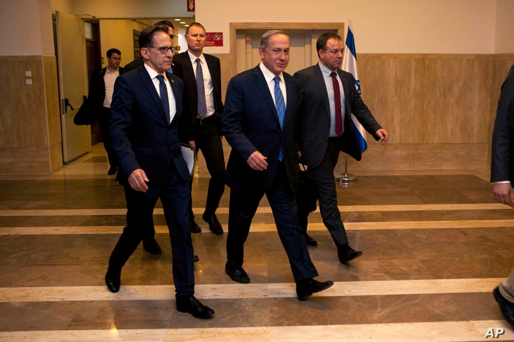 "Israeli Prime Minister Benjamin Netanyahu, center, attends a weekly cabinet meeting in Haifa, Nov. 27, 2016.  Commenting on the fires, Netanyahu said that ""whoever incites to arson, we will act against them with full force."""