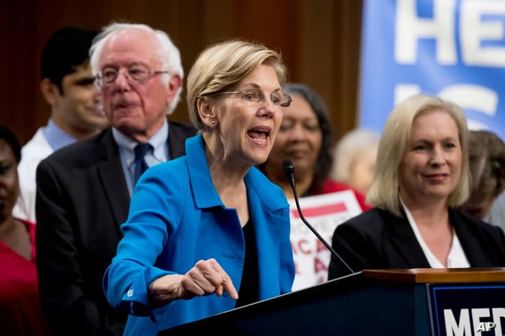 Sen. Elizabeth Warren, D-Mass., center, accompanied by Sen. Bernie Sanders, I-Vt., left, and Sen. Kirsten Gillibrand, D-N.Y., right, speaks during a news conference on Capitol Hill in Washington, Sept. 13, 2017, to unveil their Medicare for All legis...